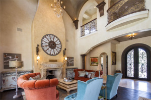 two-story living room in custom Tuscan