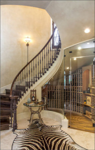 curved staircase and wineroom